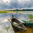 Two wooden boats are anchored, golden hours on the Lak lake, Daklak province, Vietnam — Stock Photo #13253197