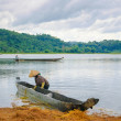 The woman and dugout boat on Lak lake, Central Highlands of Vietnam — Stock Photo #13319317