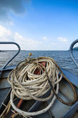 Close-up windings of rope at the head of the boat, on the sea, blue sky with clouds, Vietnam — Stock Photo