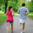 Royalty-Free Stock Photo: Caucasian couple   jogging in summer park.