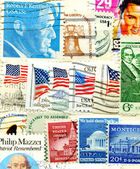 Collection of American postage stamps — Stock Photo