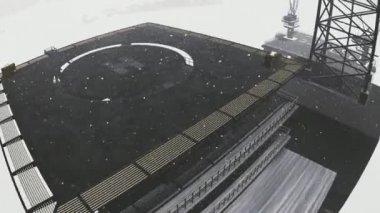 Oil rig platform standing in frozen sea — Stock Video