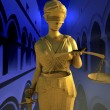 Themis in court - Stock Photo