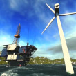 Oil rig platform and wind turbines off shore - Zdjęcie stockowe