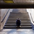 Lonely man sitting on the stairs — Stock Photo #13617605
