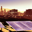 Solar power panels in city — Stock Photo #13656474