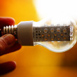 Light bulb held in palm — Stock Photo #14350521
