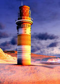 Lighthouse by the ocean at sunset — Stock Photo