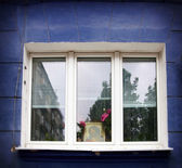 Jesus in window — Stockfoto