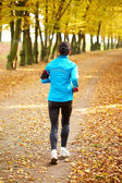 Female jogger in the park — Stock Photo