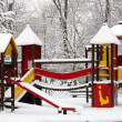 Children playground on snow blizzard - Stock Photo