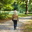 Elegant woman walking  in the park — Stock Photo