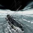 Stock Photo: Sinking pirate brigantine