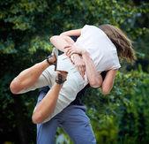 Man lifts up girl — Stock Photo