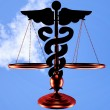 Asclepius & Justice scale — Stock Photo #30055607