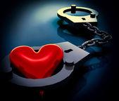 älska hjärtat i handbojor — Stockfoto