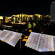 Solar panels in city — Stock Photo