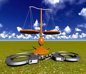 Scales of justice and handcuffs — Stock Photo