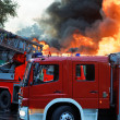 Big flames over building — Stock Photo #36924387