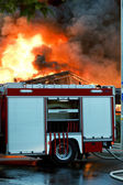 Big flames over building — Stock Photo