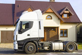 Truck in front of  suburban house — Stock Photo