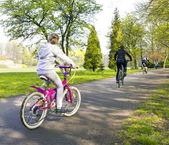 Girl riding a bike in park — Stock Photo