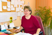 Good-humoured female teacher in her office — Stock Photo