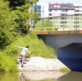 Teenage girl going under the bridge in Wroclaw, Poland — Stock Photo