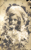 Young adorable girl on the vintage postcard — Stock Photo