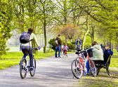 Bike riders in spring park — Stock Photo