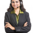 Stock Photo: Happy young Indian call centre employee