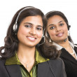 Stock Photo: Attractive young pretty girls working in a call center