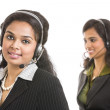 Attractive young pretty girls working in a call center — Stock Photo