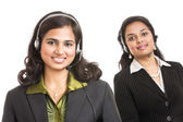 Attractive young people working in a call center — Stock Photo