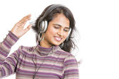 Young female with headphones on white background. — Foto Stock
