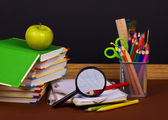 Board, books, pencils, opened empty notebook — Stock Photo