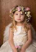 Portrait of little girl with angel wings — Stock Photo