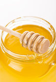 Honey in bank isolated by the white — Stock Photo