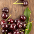 Red, ripe, juicy cherries on wooden boards — Stock Photo