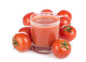 Glass of tomato juice and tomatoes — Stock Photo