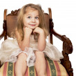 Girl on beautiful wooden chair — Stock Photo #24704041