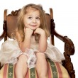 Girl on beautiful wooden chair — Stock Photo