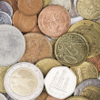 Assorted coins from different countries — Stock Photo