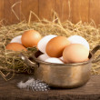 Eggs on old wooden - Stock Photo