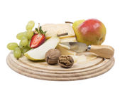 Cheese and fruit — Stock Photo