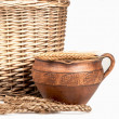 Wattled basket, clay jug — Stock Photo