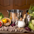 Kitchen ware and vegetables — Stock Photo