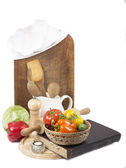 Chef's hat with battledore and cook book — Stock Photo