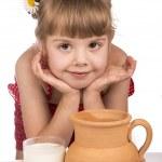 Little girl and milk — Stock Photo