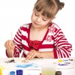 Little girl draws paints — Stock Photo